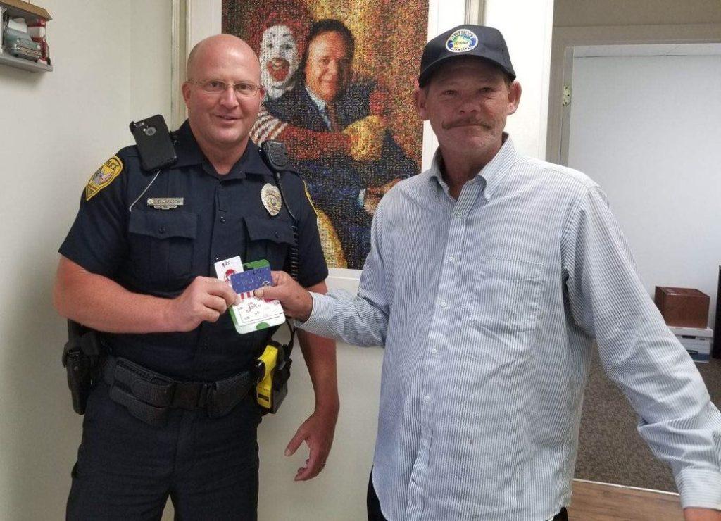 policeofficer shaves homeless man's beard